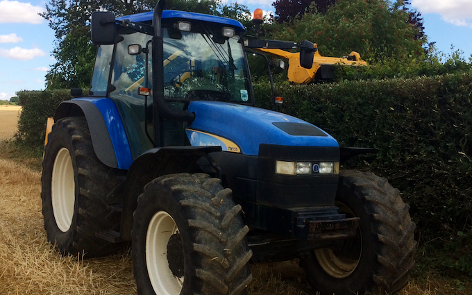 T wasteney  with Hedge cutter at United Kingdom
