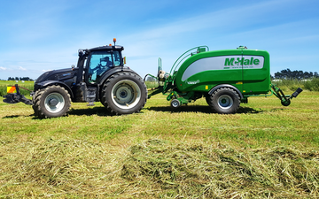 Three rivers contracting  with Round baler at Wyndham