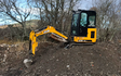 Wee jim landscapes with Mini digger at United Kingdom