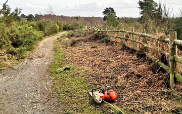 Wildscapes countryside contractors with Chain saw at Church Crookham