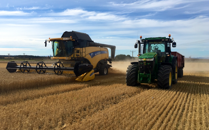 Robert carswell and sons with Combine harvester at United Kingdom