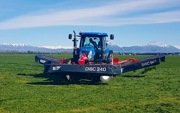 Mid canterbury baling ltd with Mower at Cavendish